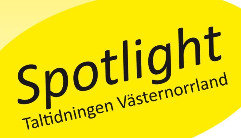 Spotlight gula strålkastarljus med tidningens namn i svarta bokstäver